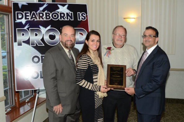 Mayor John B. O'Reilly, Jr. (left) honored the 2014 Volunteer of the Year Derek Hughes (center) at   the annual Volunteer Recognition Breakfast organized by the Dearborn Senior Services Division   of the Recreation and Parks Department on Oct. 8. Joining in the congratulations were Council   President Susan Dabaja (second from left) and Councilman Michael Sareini (right).