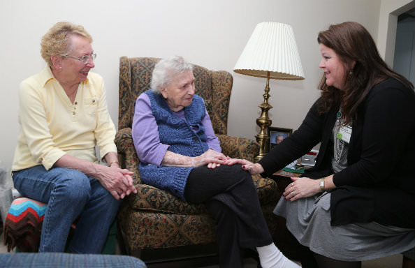Marcia Filek, geriatric care manager for Senior Care Solutions by Oakwood, visits with Blanche Ciarkowski and daughter Marcia Waugh.