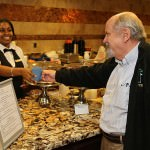 Ordering a cup of coffee, Rev. Dr. Richard Bleivik chats with one of the friendly servers in Oakwood Common's Bistro.