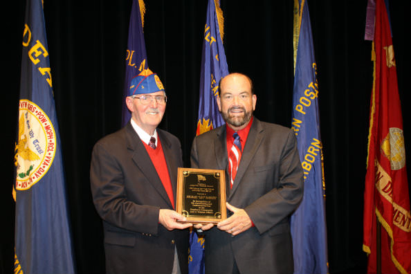 Dearborn's 2014 Veteran of the Year Leo Barrett was congratulated by  Mayor John B. O'Reilly, Jr. during Tuesday's Veterans Day Ceremony. (photo courtesy of the City of Dearborn)