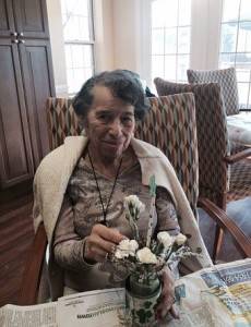 Resident Hazel Dawson works on the floral arrangement for her  apartment at Oakwood Common.