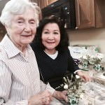 Dearborn Garden Club members Eve Toohey, at left, and Gloria Rusin assemble flowers and materials for the workshop.