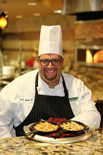 Executive Chef Jamie Minton displays warm apple pies for two, served table-side in individual skillets.
